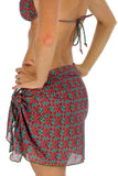 Tan through sarong in green Hibiscus.