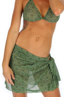 Short swimsuit coverups in green Caged print -- tan through.