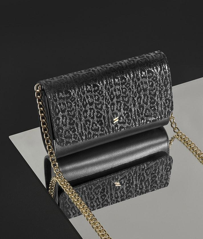 black leather crossbody bag with leopard print