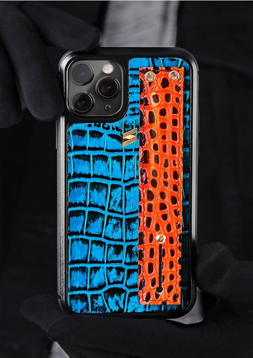 The Benny case for iphone 11 pro in blue with with hand painted crocodile print and a strap