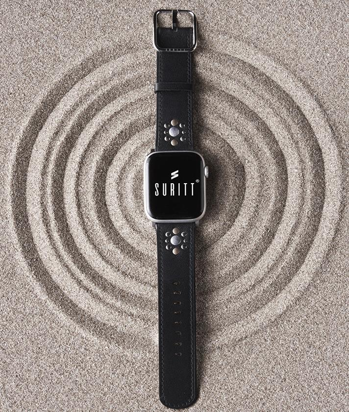 A black leather apple watch band with tacks
