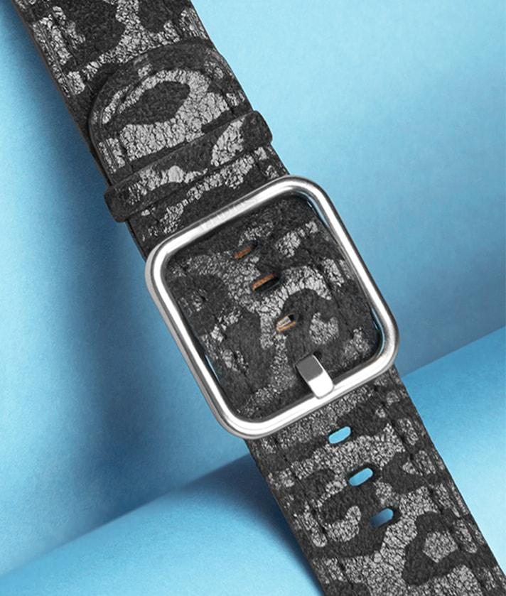 A leather strap for apple watch with black leopard print