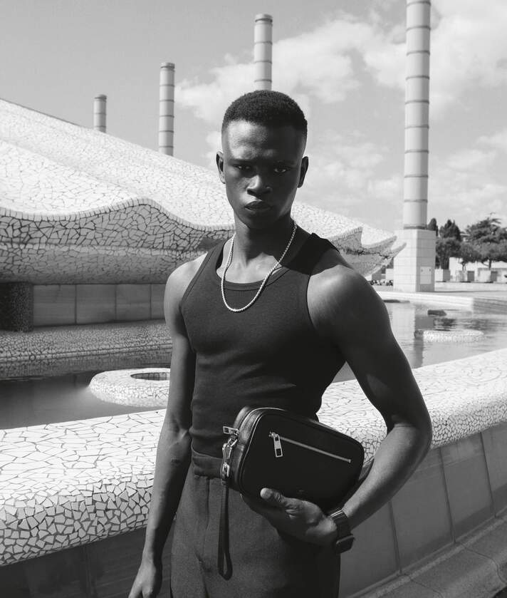 man with black leather clutch in Barcelona