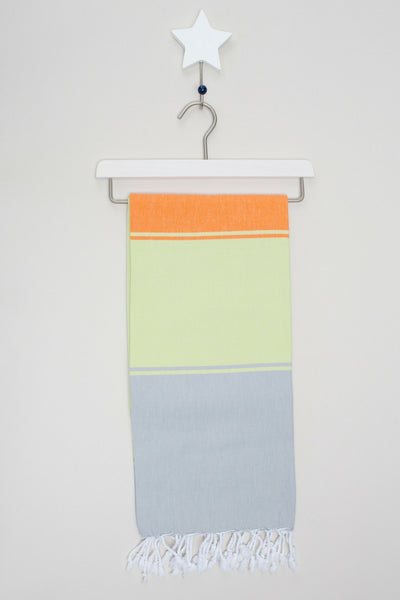 Annecy hammam towel in kiwi and tangerine from sand and salt