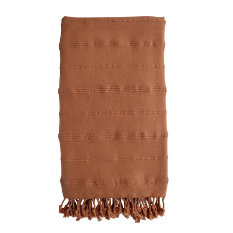 Cove Stonewashed Hammam Towel in plain cinnamon orange colour with textured stripe design. With knotted fringing at both ends.