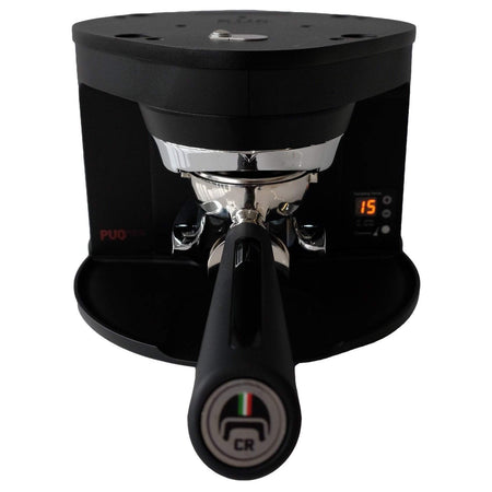 Puqpress M1 Automatic Tamper for Mahlkonig Grinders - black front view with portafilter - at Total Espresso