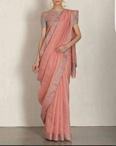 BHLSPE01- salmonish peach linen saree with silver zari border border