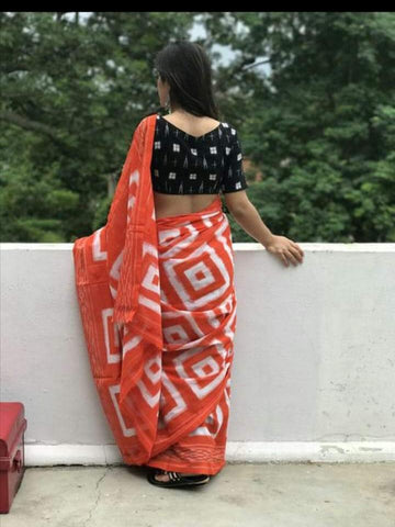 KPIPMCS1-designer ikkat pattern block printed orange  malmal cotton saree with black printed blouse