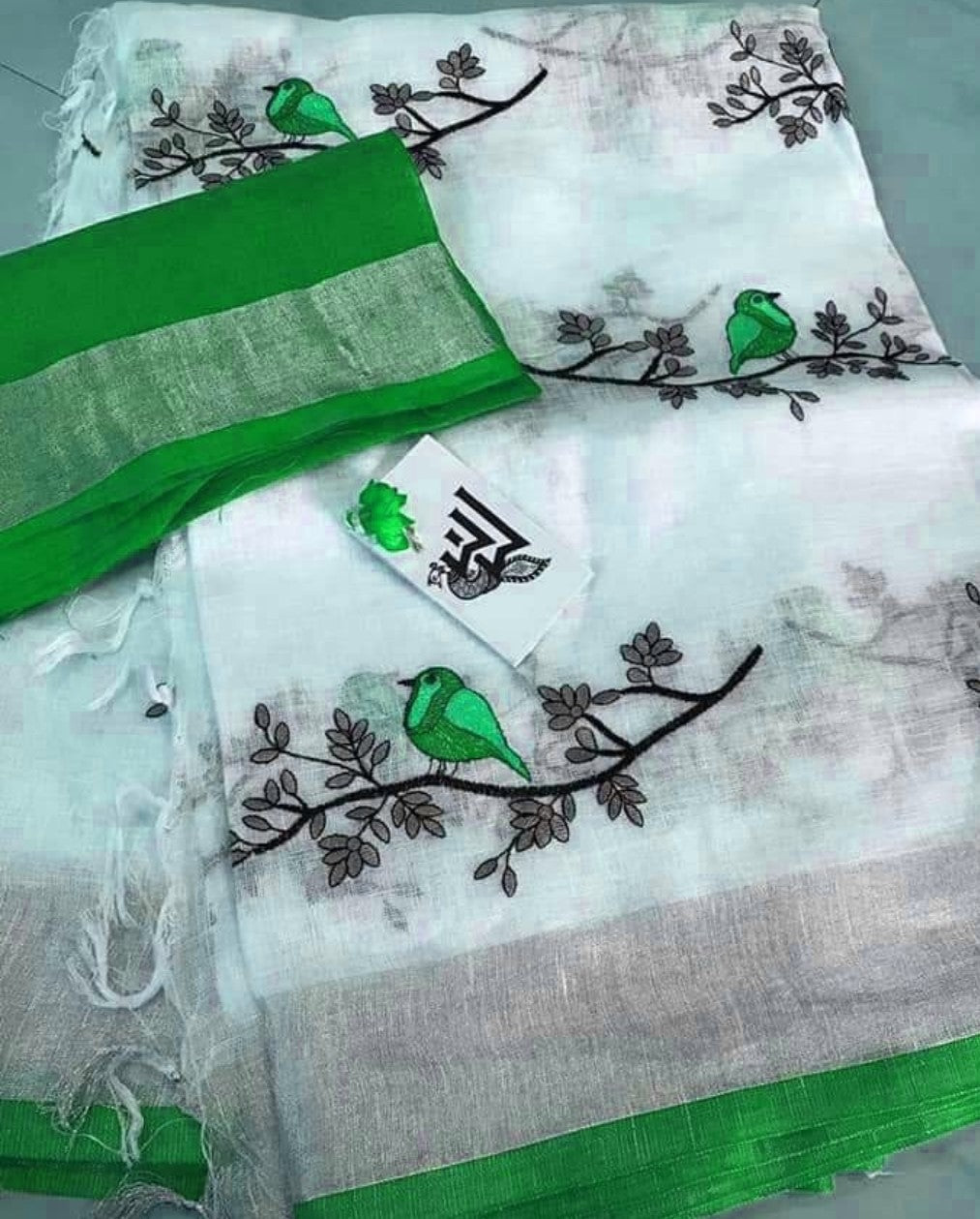 0f4c6deacbc5a BSWPGBLS- white and parrot green bird on tree embroidered linen saree with silver  zari border. prev