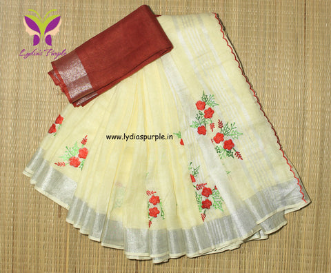 BSBFLS-  Biscuit colour floral embroidered linen saree with silver zari border and contrast blouse