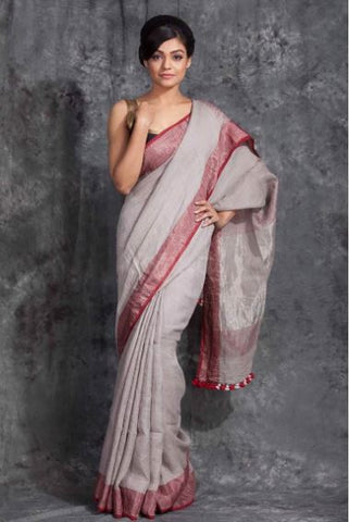 BGRMLS-  Grey linen saree with  maroon zari border and running blouse
