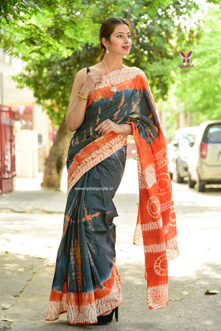 KMGOBVS-designer grey (cement shade) and orange shibori malmal cotton saree with blouse