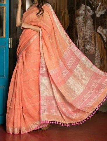 orange linen saree with golden zari border