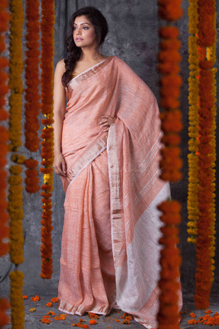 BPSZ01- Peach linen saree with silver zari border and Running blouse