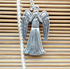 Dr Who Wheeping Angel Pendant Necklace  FREE SHIPPING....