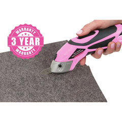 Pink power scissors cutting through felt fabric.