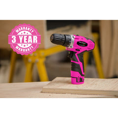 Hot pink power tool on work bench.