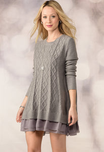 Flirty cable knit tunic sweater