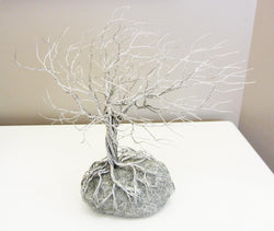 Deeply Rooted Windblown Tree Metal Sculpture