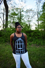 Female model wearing a dark grey racerback tank top with the No Egrets Birdcage logo in light grey on the front.