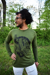 Male model wearing a green, long-sleeved shirt with Cameron McKnight's Dragon design in black on the front.