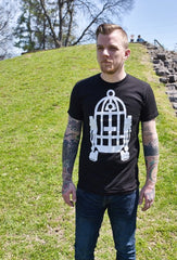 Male model wearing a black t-shirt with Fred Palmer's Robot Birdcage design in white on the front.