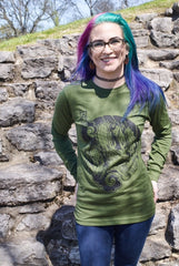 Female model wearing a green, long-sleeved shirt with Cameron McKnight's Dragon design in black on the front.