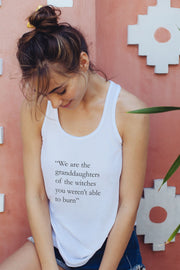 model wearing a white tank with the Wiccan quote on it