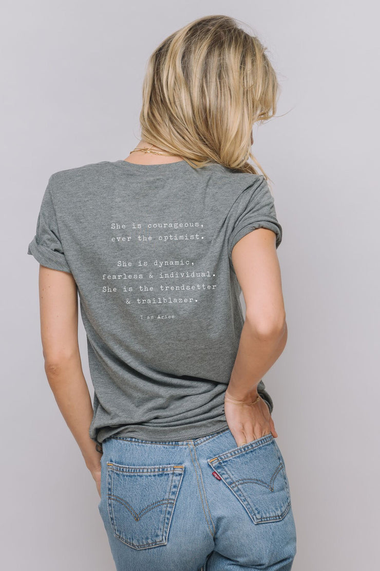 "dark grey t-shirt ""She is courageous, ever the optimist.  She is dynamic, fearless & individual. She is the trendsetter & trailblazer"""