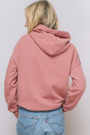 "model wearing a ""Strong Heart"" hoodie in a rose version"