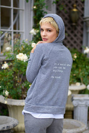 model in an eco grey fleece zip up
