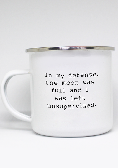"lightweight mug with ""In my defense, the moon was full and I was left unsupervised."" on it"
