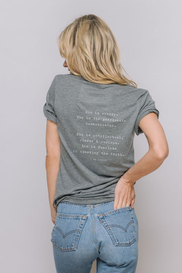 "model in a dark grey t-shirt ""I Am Gemini"""