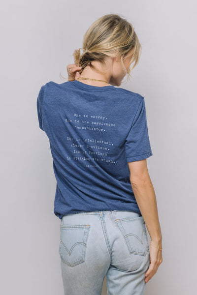 "Navy blue tee with the quote ""She is energy. She is the passionate communicator. She is intellectual, clever & curious. She is fearless in speaking the truth"" on it"