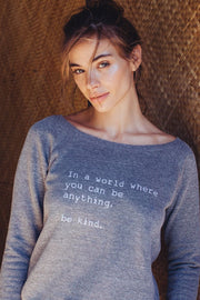 model in a grey cozy pullover with sayings on it