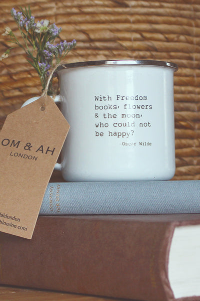 white mug with an Oscar Wilde quote on it