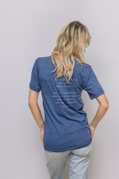 "Navy tee with ""She is intuitive. She is the most faithful. She is compassion, selfless & artistic. She is known for her wisdom"" on it"