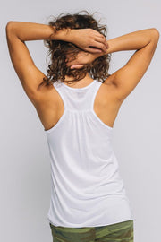 In a world where you can be anything white flowy tank