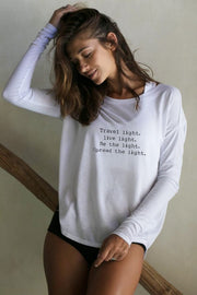 model wearing a Be the Light white long sleeve tee