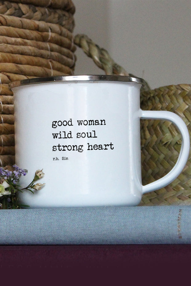"white enamel mug with saying ""Good woman, wild soul, strong heart"""