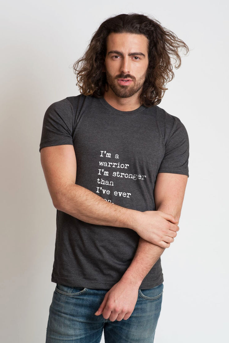 "mens charcoal tee with the tee ""I'm a warrior I'm stronger than I've ever been"" on it"