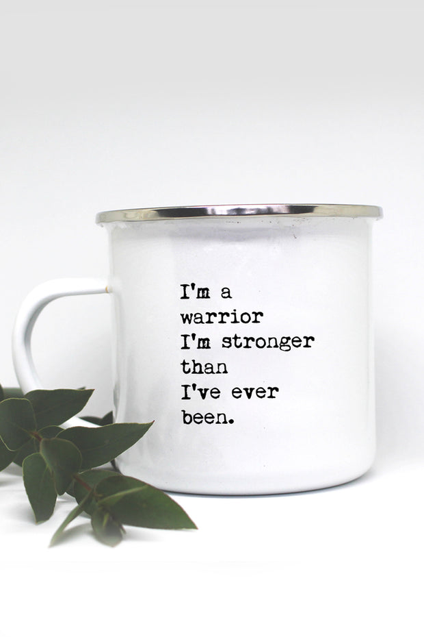 "a white mug with the quote ""I'm a warrior I'm stronger than I've ever been"""