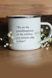 a white enamel mug with saying on it