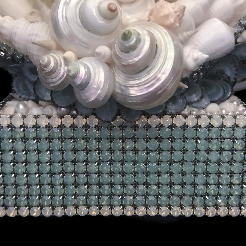 Front close up of base of coral centerpiece featuring pacific opal swarovski © crystals and natural seashells