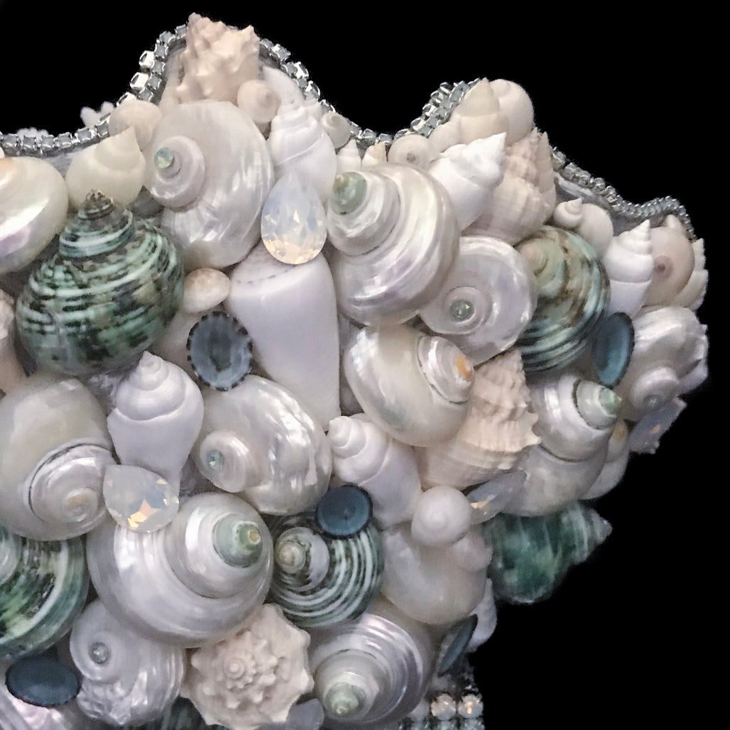 Right side of coral centerpiece featuring pacific opal swarovski © crystals and natural seashells