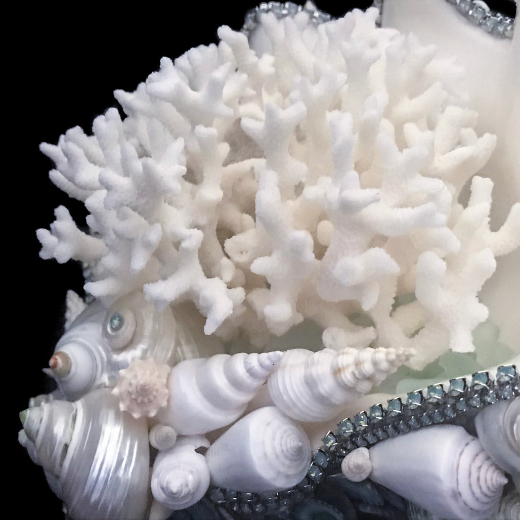 Coral centerpiece featuring pacific opal swarovski © crystals and natural seashells