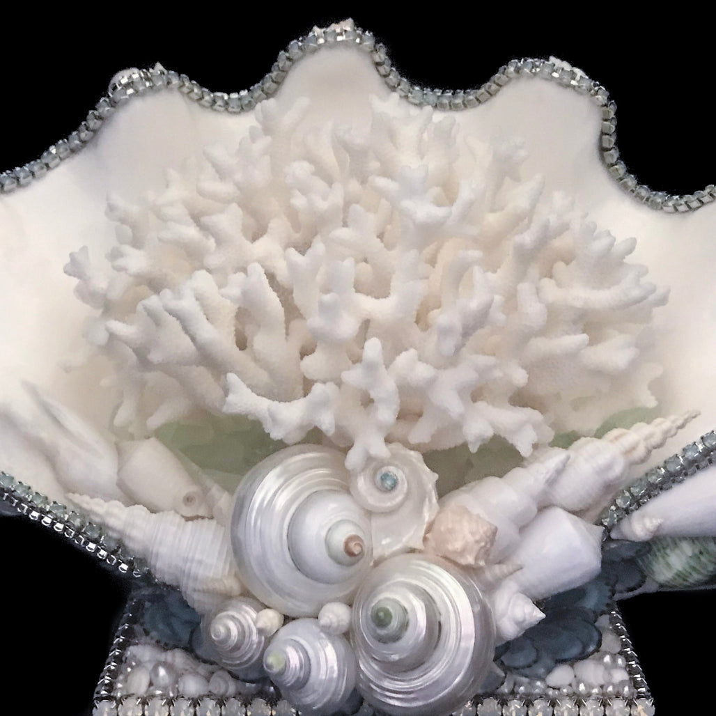 Close up of coral centerpiece featuring pacific opal swarovski © crystals and natural seashells