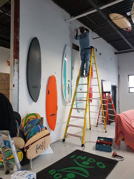 Grant setting up the magical 'gnarwall' of surfboards. To date none have fallen down.