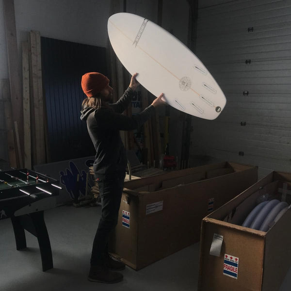 We love to receive new surfboards. Kristen captured Jeff with the late afternoon sun.