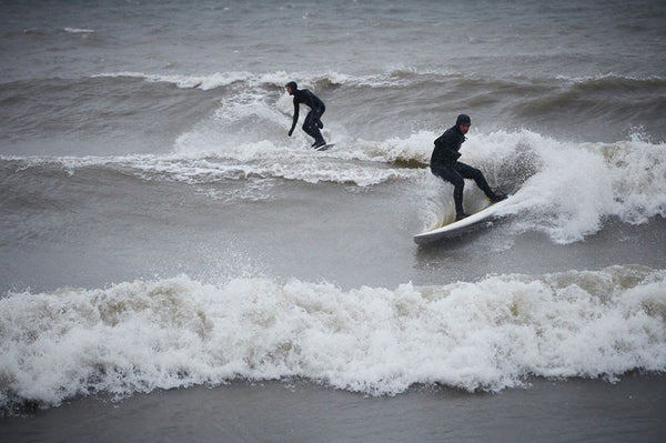Geoff Ortiz on the SUP and Alex Boutilier trailing on Lake Ontario. Photo by Seed9.